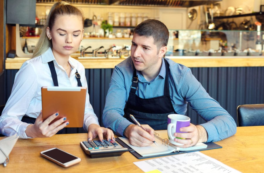 small business owners calculating expenses