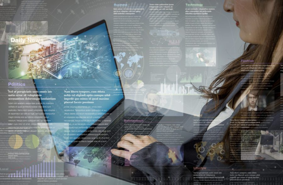 A woman developing a content marketing strategy on a laptop.